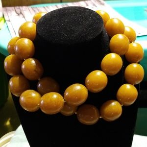 Vintage chunky lucite necklace.  Orange/brown.